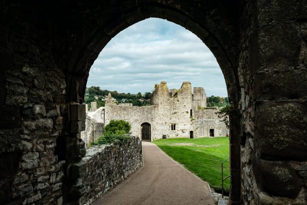 Castle viewed through an archway showing large grounds